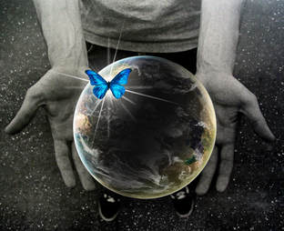Planet Earth, blue butterfly, hands